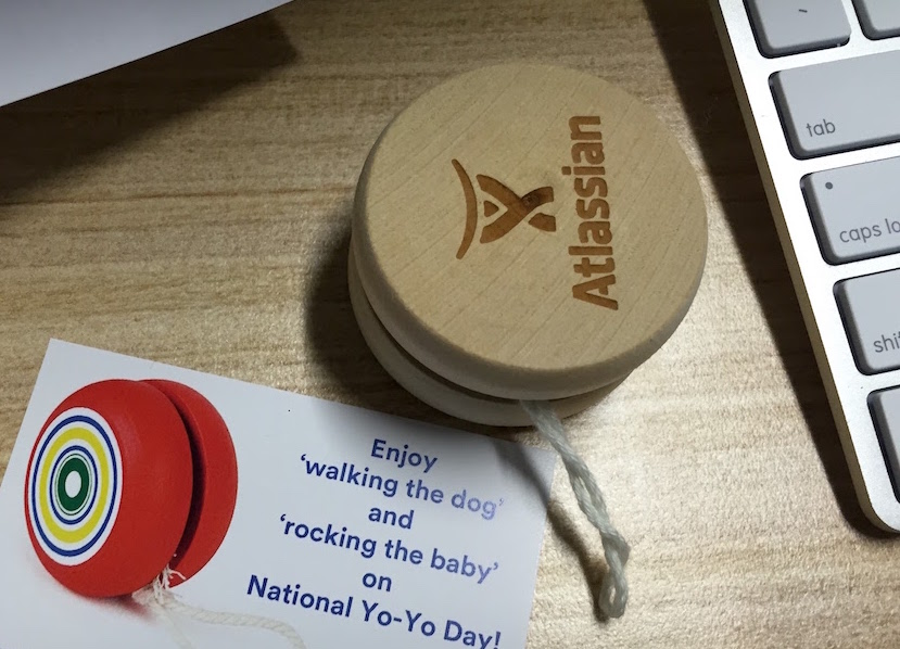 A yo-yo I received from Atlassian. Card next to it says walk the dog and rock the baby.
